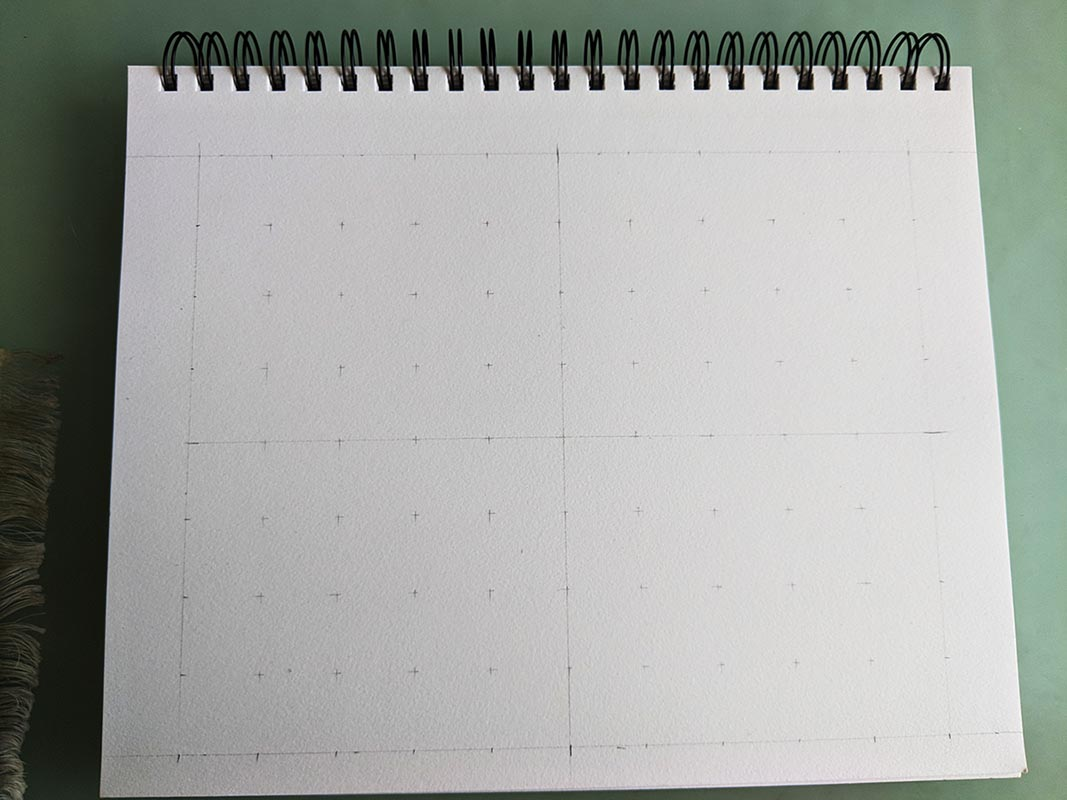 A picture of a sketchpad with a grid drawn on it.