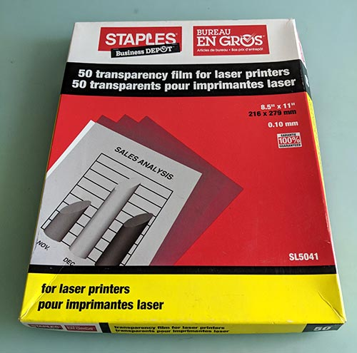 A photo of a pack of transparency film for laser printers.
