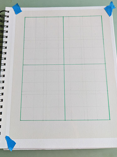 A picture of a sketchbook with a transparency and grid.