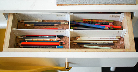 A picture of pencils in a drawer.