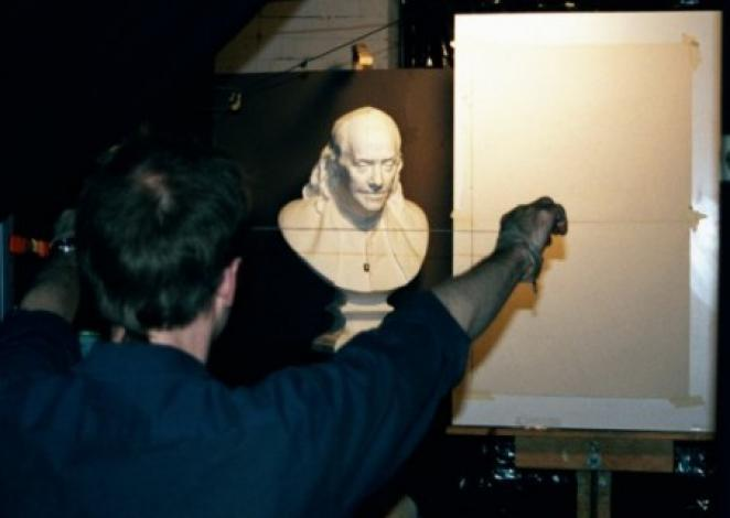 An Artist using the sight-size method.